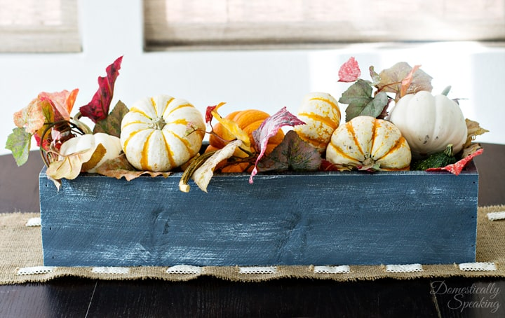 Fall Rustic Trough filled with pumpkins and leaves.
