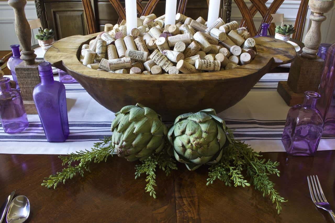 Wine corks in a large wooden bowl as a centerpiece.