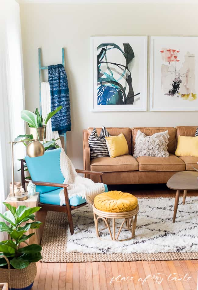 This fun and boho living room decor is great! You need to see the before picture! What a transformation from a messy playroom to a brigh, boho living room!
