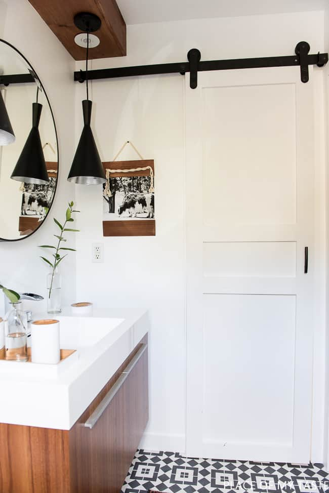 Learn how to make this modern DIY sliding barn door. It's easy and adding a