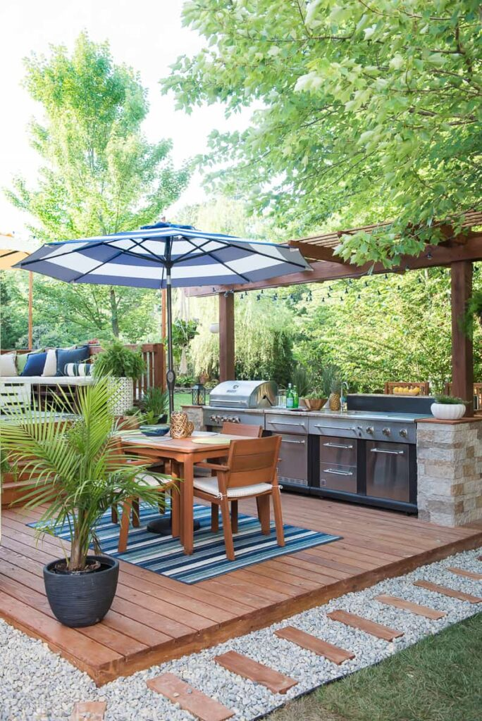 This outdoor patio is so amazing. And that includes an outdoor kitchen too!