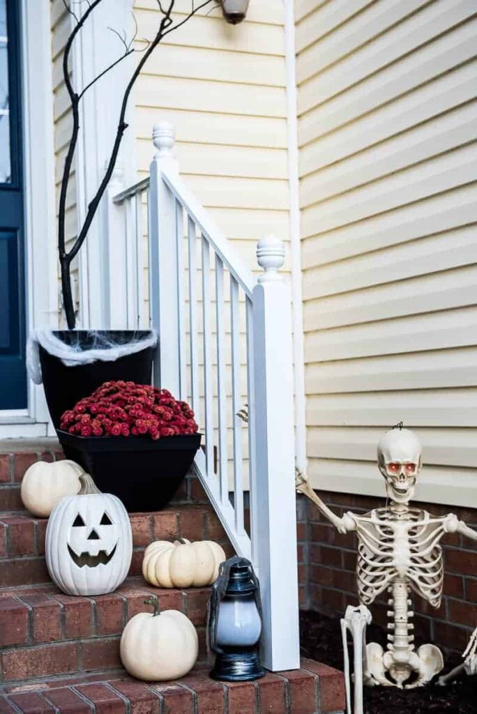 pumpkins and skeletons on the front stairs