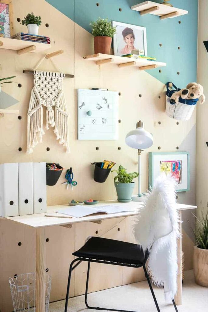 photo of the giant peg board wall and desk area