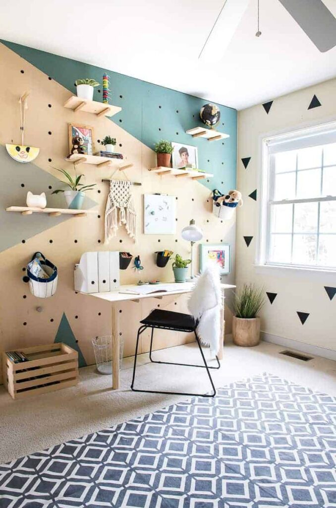 amazing DIY giant plywood pegboard wall with photos and decor and trinkets added