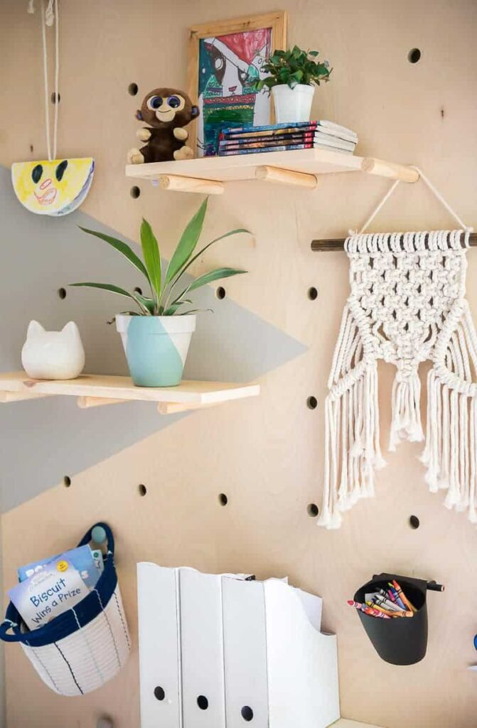 Holy WOW! This amazing DIY giant plywood pegboard wall is so easy to make and it looks super cool!