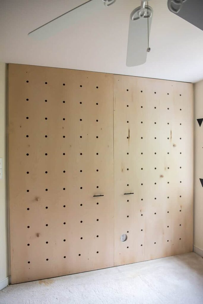 plain pegboard plywood pieces mounted to the wall