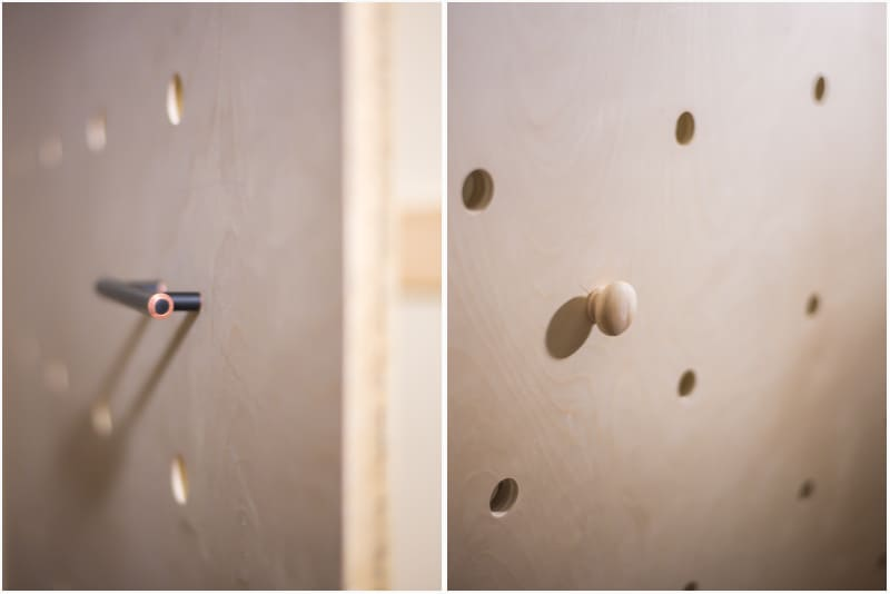 adding handles and knobs to the pegboard before mounting on wall