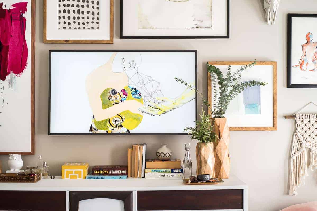 An amazing gallery wall with the frame tv you can also upload and display your photographs of family friends and experiences how cool is that all you need to do is to download the samsung apps jeuxipadfo Choice Image