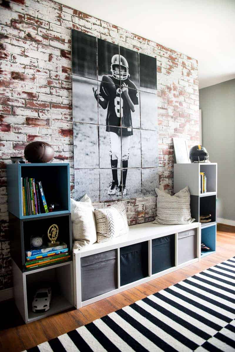 Photo of boy in football jersey tossing ball to himself printed to multiple images and mounted on the wall on floating foam boards