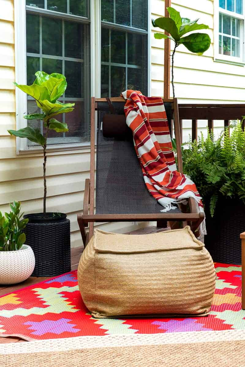 sling back rocker with striped blanket tossed over the back