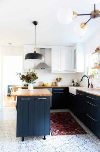 Beautiful two toned kitchen with butcher block countertops!