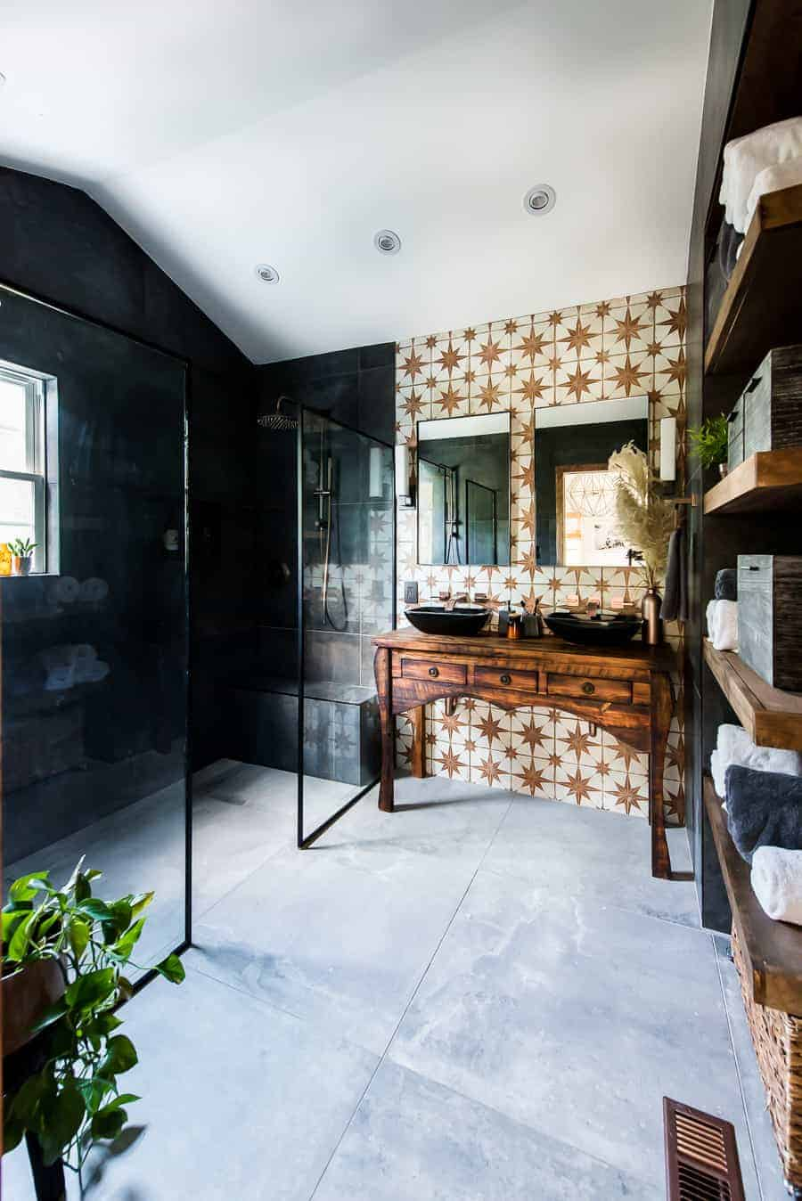 Fabulous master bathroom design with black tiles.