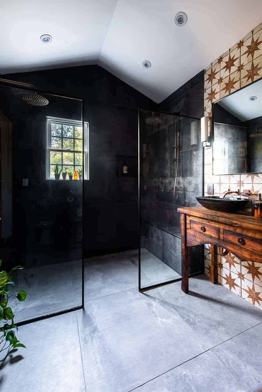 Black large scale tile in bathroom.
