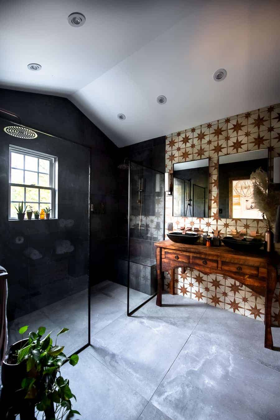 Such a beautiful master bathroom with vintage vanity.