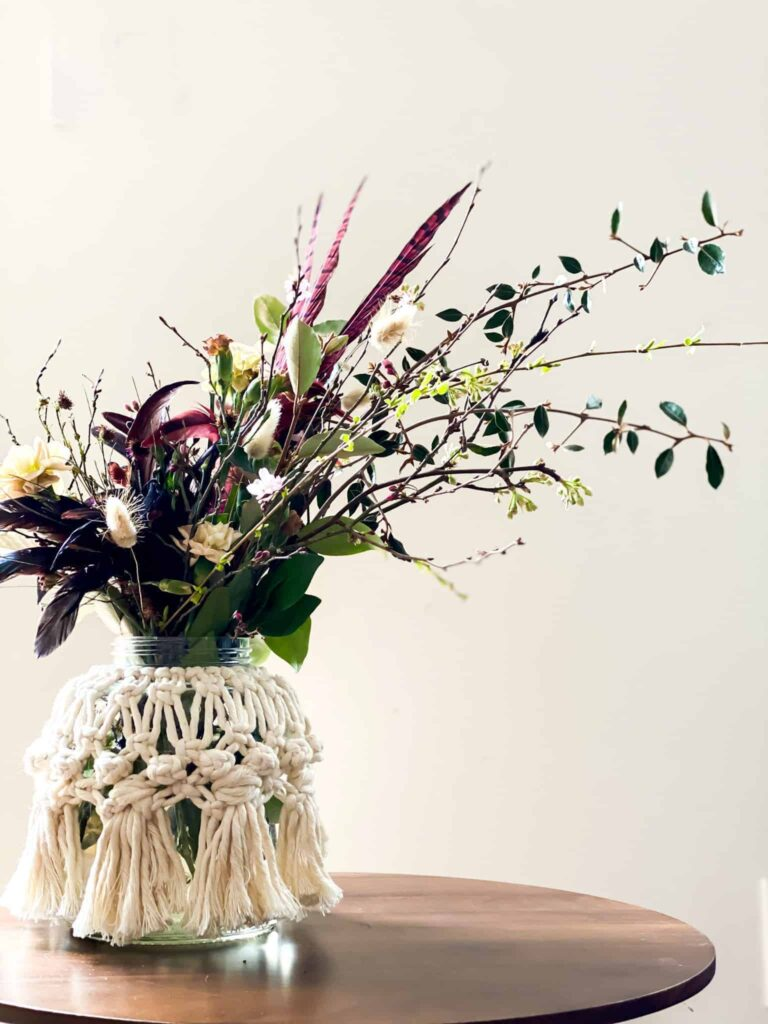 Macrame vase cover and moody floral arrangement