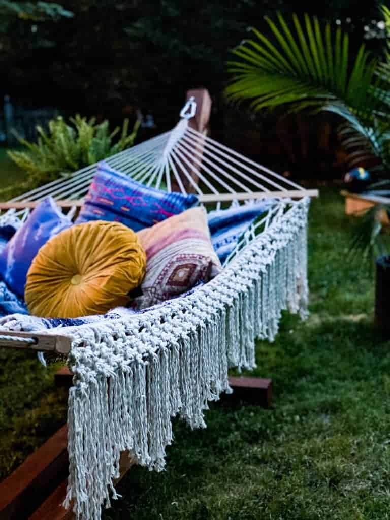 Cozy hammock stand with boho hammock and pillows