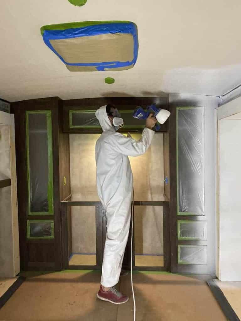Spray painting rv walls. Camper renovation